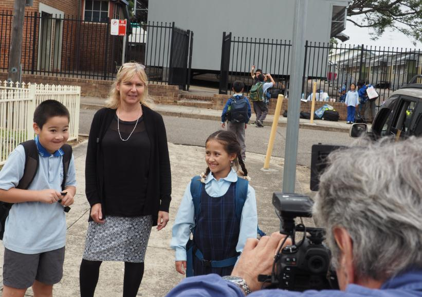 A teacher and two students being filmed for the road safety video.